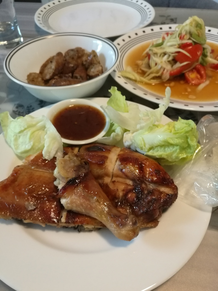 BBQ chicken, papaya salad with sticky rice